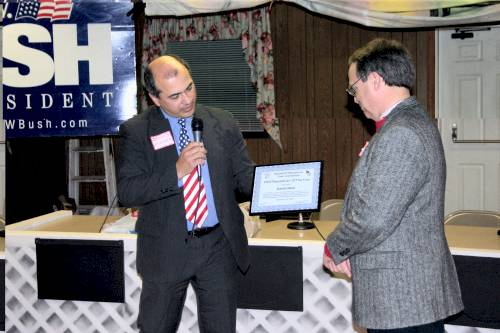 Dennis Fonseca presents Dave Neal with 2005 Republican of the Year Award at the President's Day Event